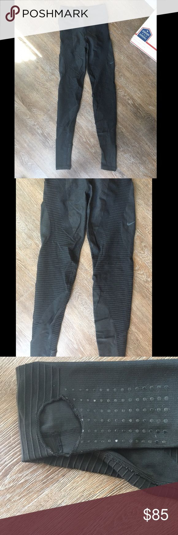 Nike zone sculpt tight Size- Small Condition- Like new 9.5/10 (worn once and washed once) Color- Different shades of black   No flaws that I've noticed   High waisted   Very stretchy   Heels holes with sticky bottoms for studio dancing  Great for people with long legs  Thanks for looking! Nike Pants Leggings