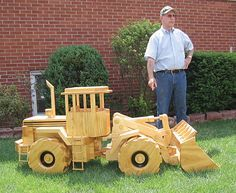 A yard full of wooden construction equipment models in large scale   Woodworking ideas