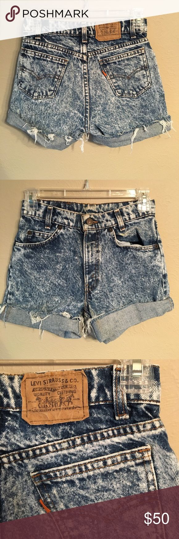 """Vintage Levi's orange tab acid wash shorts Vintage Levi's orange tab acid wash high waisted cut off shorts. Size XS. Would fit size 23. Waist 12"""" across, hips 16"""", rise 9.75"""". Little yellow spot on pocket but it's not too noticeable. Levi's Shorts Jean Shorts"""