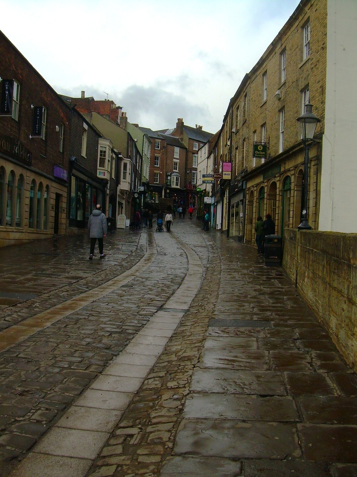Durham, County Durham, England~Shopping on cobblestone streets between rainshowers