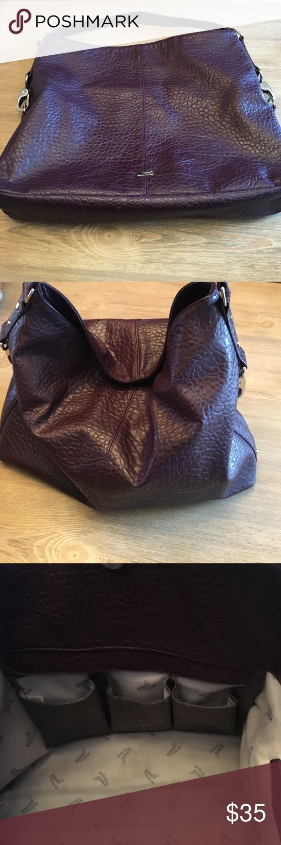 Thirty one purse Cognac pebble color purse.  Used for a few months. Does have one small scratch on the front.   Sooooo roomy!  I have used this as a diaper bag too! Bags
