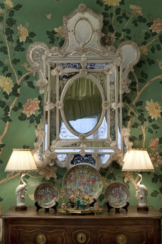 Pretty antique wallpaper and mirror - great lamps - these make for a perfect vignette