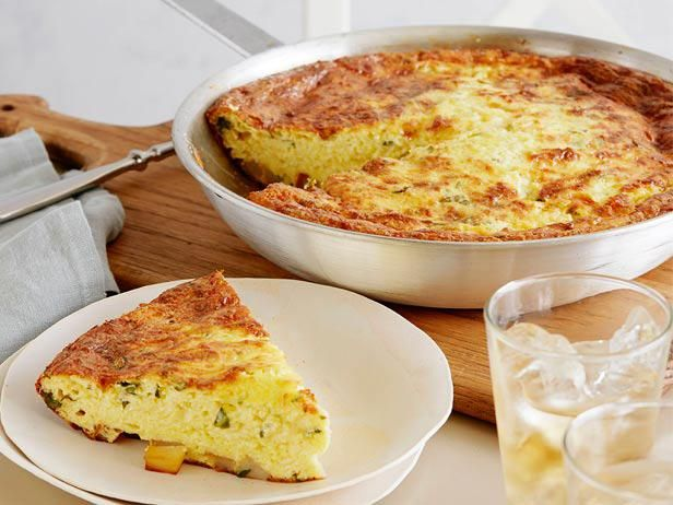Serve a slice of Ina's Potato Basil Frittata that's filled with two types of cheese, diced potatoes and chopped fresh basil.