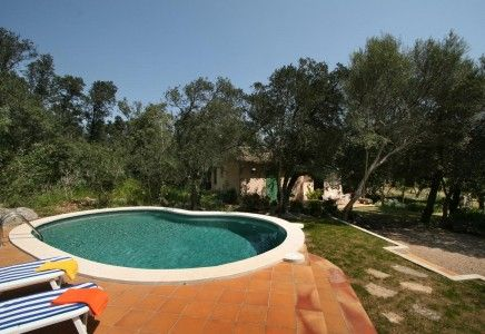 Villa Font March is set amongst a natural small wood with fragrant pines trees and oaks. It is situated in the edge of La Font area very close to the town of Pollensa and just a few minutes drive to the beach resort of Port Pollensa.<br /> <br /> This simple and comfortable cottage is a great holiday base, is all in one level and has a lovely mosaic kidney shape swimming pool which is surrounded by bushes, young oak trees and pine trees. The lateral terrace has a pergola which in the summer…