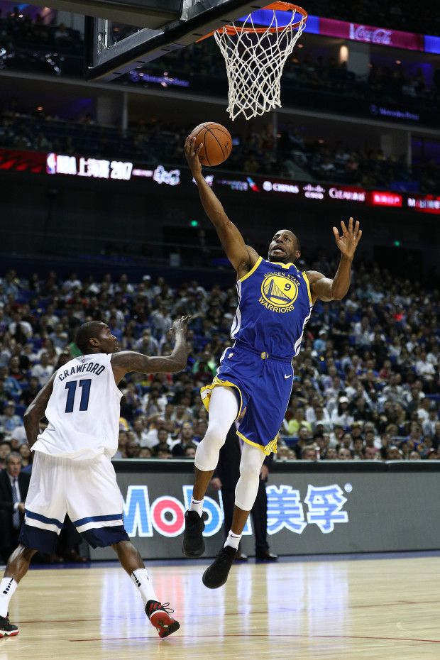 SHANGHAI, CHINA - OCTOBER 08: Andre Iguodala #9 of the Golden State Warriors in action against Jamal Crawford #11 of the Minnesota Timberwolves during the game between the Minnesota Timberwolves and the Golden State Warriors as part of 2017 NBA Global Games China at Mercedes-Benz Arena on October 8, 2017 in Shanghai, China. (Photo by Zhong Zhi/Getty Images)