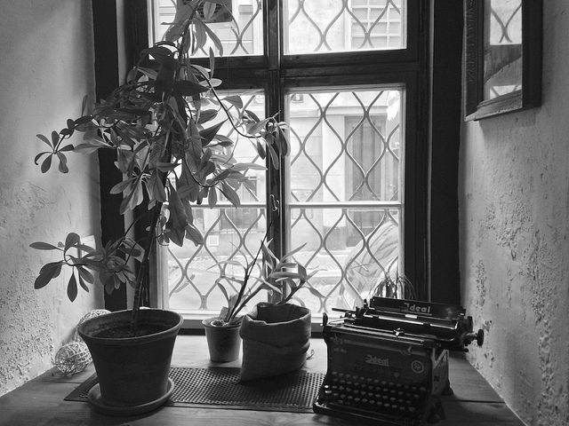 Typewriter near windowsill