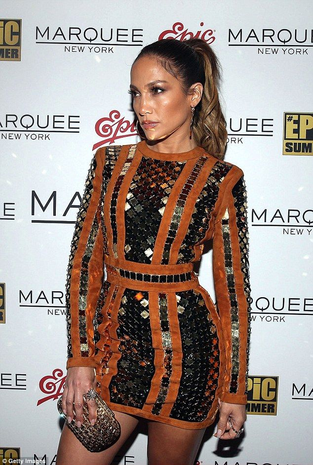 Glamorous: JLo wore her long locks pulled back from her face in a high ponytail and accentuated her age-defying features with plenty of bronzer