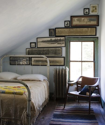 In love with the long, oddly shaped antique framed prints with the sharp slant of the wall.
