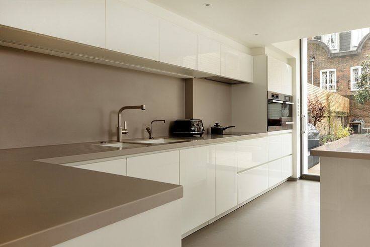 By far the most popular handleless kitchen colour is white. However, very often mixed with a contrasting colour or wood island or feature wall cabinet.