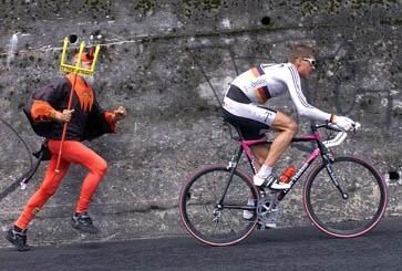 Jan Ullrich being chased by Didi 'The Devil ' Senf. Great shot