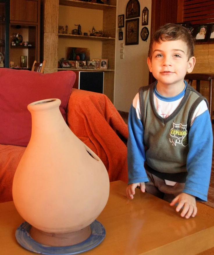 My son Giannis and the bisque fired UDU drum