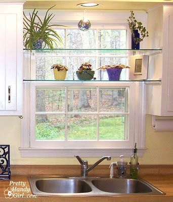 Glass shelved in kitchen window, great for an herb garden.  Must do this.