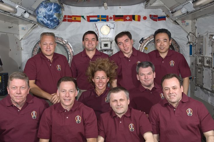 S135-E-008082 (15 July 2011) --- The Expedition 28 crew and the STS-135 Atlantis astronauts take a break from a busy day in space to pose for a portrait aboard the orbiting complex's Kibo laboratory of the Japan Aerospace Exploration Agency. The STS-135 crew consists of NASA astronauts Chris Ferguson, Doug Hurley, Sandy Magnus and Rex Walheim; the Expedition 28 crewmembers are JAXA astronaut Satoshi Furukawa