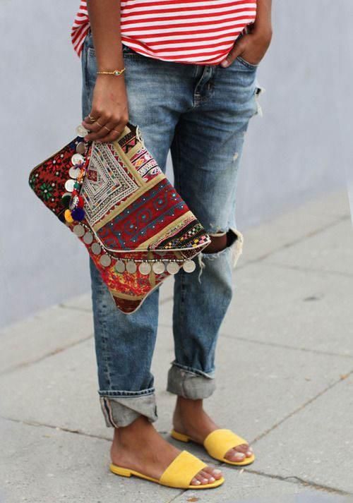 boho summer: hippie chic via the style files. striped tee, distressed jeans, batik clutch and yellow slippers.