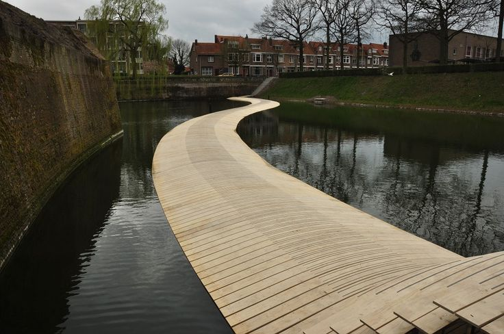 Floating bridge to monument the Ravelijn, Bergen op Zoom, by RO&AD. The curvy shape resembles the route boates used to take to stock the fortification. Nice curved deck. Photo by Eric Wientjens.