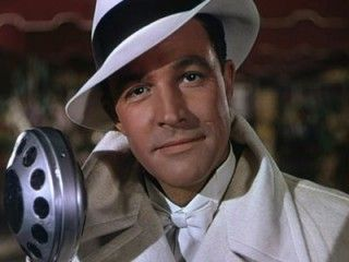 Gene Kelly, By far my favorite actor of yesteryear. He never fails to make me smile.  Wish I had written him when I was a little girl before he passed.  Still regret that.  Oh and seriously, he had the nicest butt in Hollywood back in the day!  lol