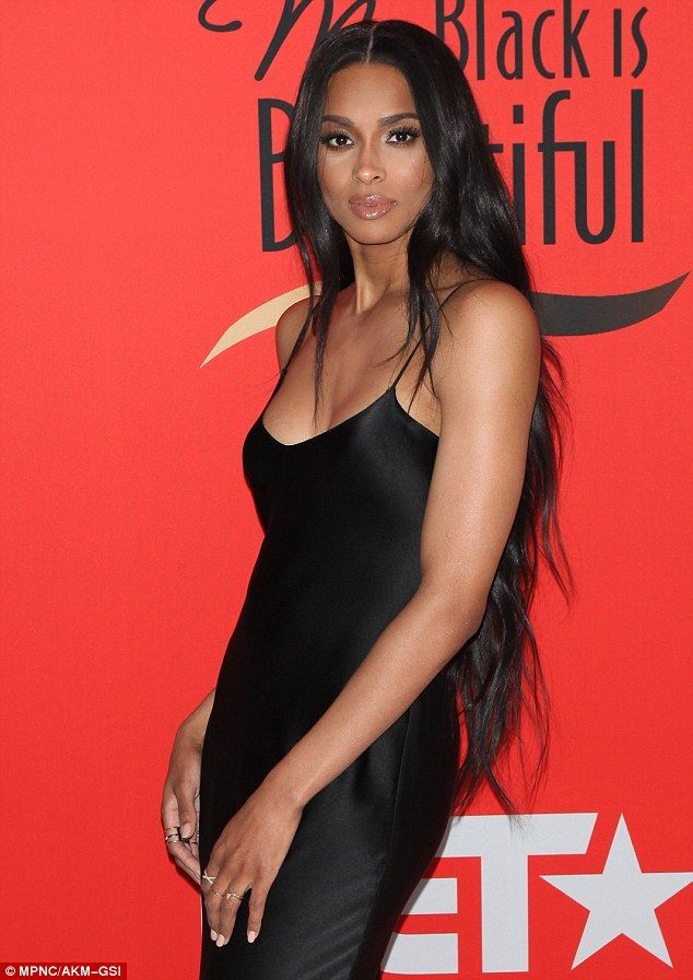 In fine form: Ciara highlighted her gorgeous figure in the frock as she posed on the red c...