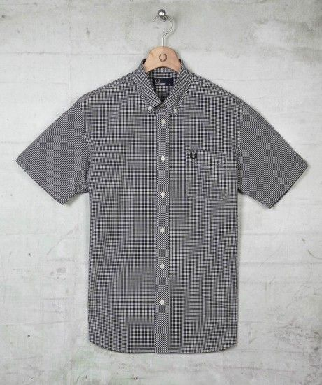Classic short sleeved gingham shirt created in smooth cotton poplin, featuring traditional styling details, such as a button down collar, notched cuffs and patch pocket on the chest embroidered with our iconic Laurel Wreath design. Perfect layered under b