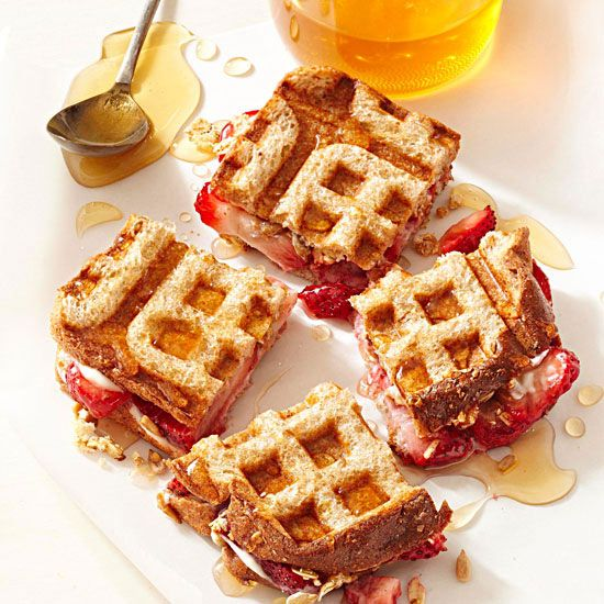 This healthy breakfast sandwich is made with whole grain bread, light cream cheese, strawberries, and low-fat granola. More healthy breakfast recipes: http://www.bhg.com/recipes/healthy/breakfast/heart-healthy-breakfast-recipes/?socsrc=bhgpin040913wafflesandwiches