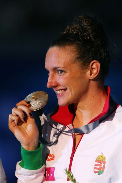 Gold medal winner Katinka Hosszu of Hungary celebrates on the podium after the Swimming Women's Medley 400m Final on day sixteen of the 15th FINA World Championships at Palau Sant Jordi  on August 4, 2013 in Barcelona, Spain.