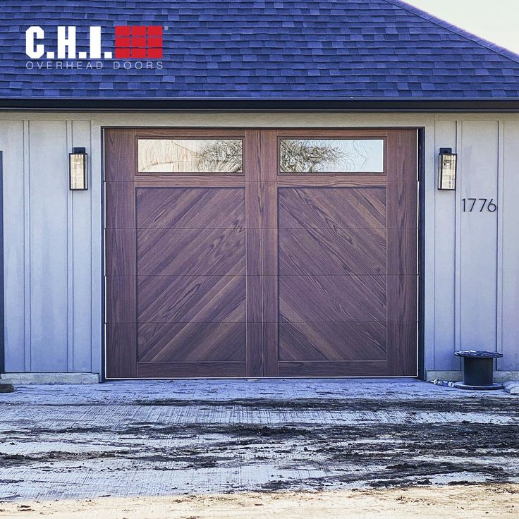 Faux Overlay Steel Garage Door Flush Overlay In Dark Oak Accents Herringbone Design In 2021 Overhead Door Modern Garage Doors Garage Doors