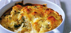 Cauliflower and cheese bake Ingredients 1 small cauliflower 2 eggs, beaten 200g fat-free natural yogurt 1 tbsp dried onions 2 tbsp freshly chopped parsley 40g reduced fat cheddar cheese, grated Pinch of mustard powder Method Preheat the oven to 180°C/160°C Fan/Gas Mark 4. Steam the cauliflower for approximately 5 minutes. Drain and transfer to an oven-proof dish. Mix together the remaining ingredients and pour over the cauliflower. Bake in the oven for 20-25 minutes until crisp and golden.