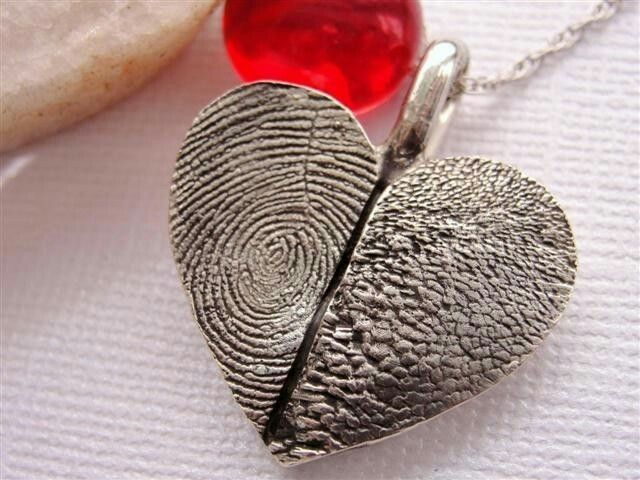 Fingerprint/Paw Print Heart Necklace. This is AWESOME! You will receive a mold making kit to take fingerprint of child, husband or yourself: and paw print of pet. You receive sterling heart with prints on front, names engraved on back. $204.99. Rockmyworldinc on Etsy