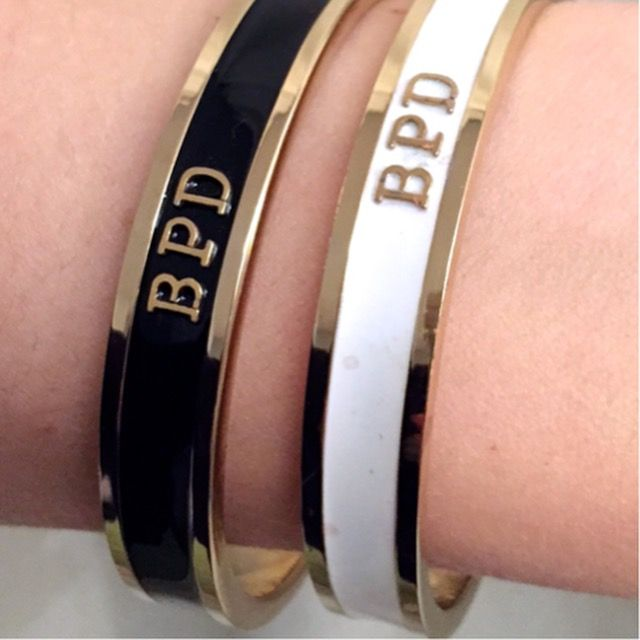 THESE STATEMENT GOLD OR SILVER PLATED BANGLES ARE HAND-FILLED WITH BLACK, CREAM, MINT OR GREY GLOSSY ENAMEL AND HANDMADE IN LONDON WITH YOUR DESIRED MESSAGE.FOR EXTRA INNER ENGRAVING, PLEASE CLICK HERE.MODEL WEARING 64MM DIAMETER
