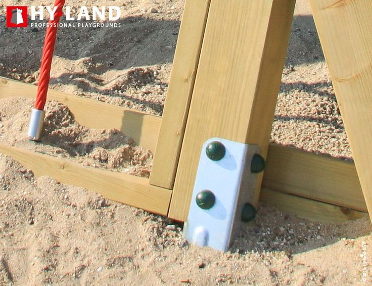 tandard piece of safety commercial playground equipment: Swing set anchors for safe and secure playtime on the outside play equipment for children.