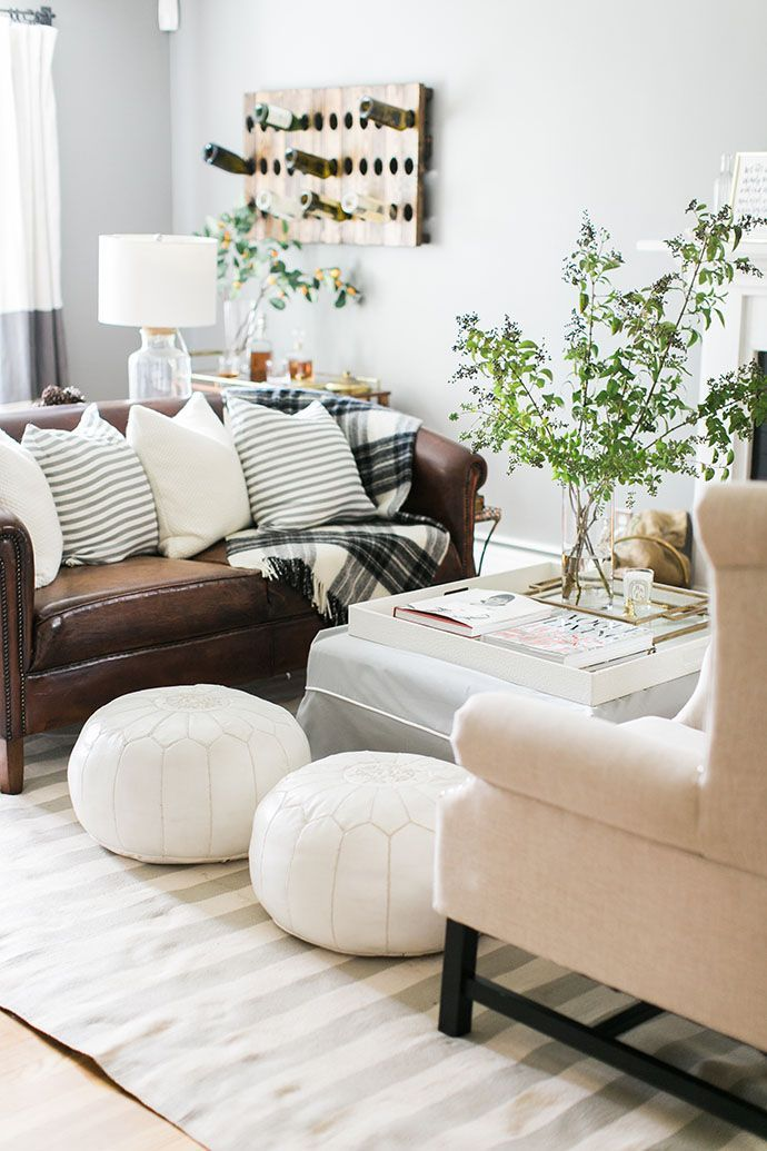 living room with white moroccan poufs