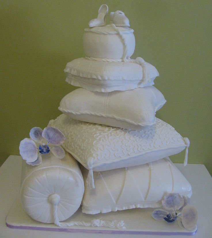 Fantasy Pillow Wedding Cake - fantasy wedding pillow cakes covered in fondant and decorated with fondant ribbons, laces and designs and gum-paste shoes and flowers. serves 250