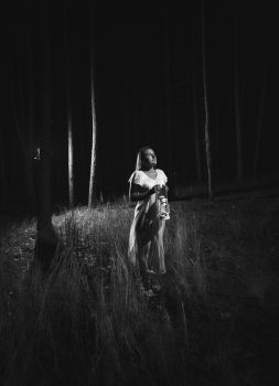 #Blackandwhite #photo of #woman in #whitedress walking at #forest at night with lamp  #ghost #ghoststories #creepy #halloween #dark #scary #alone #creative