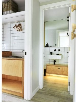 """WHAT THE JUDGES THOUGHT: The panel admired the bathroom for its great choice of materials – plywood, copper and a concrete-look tile – that pay homage to the original bach. """"The dark fittings are a classy touch."""""""