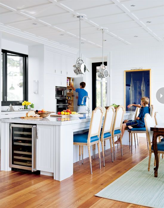 Kitchen design: Bright white kitchen with hints of royal blue {PHOTO: Donna Griffith}