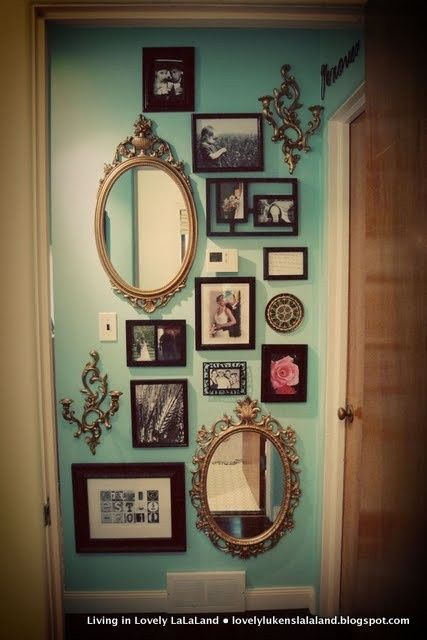 Love the uniqueness of one random focal wall with victorian mirrors and modern frames!