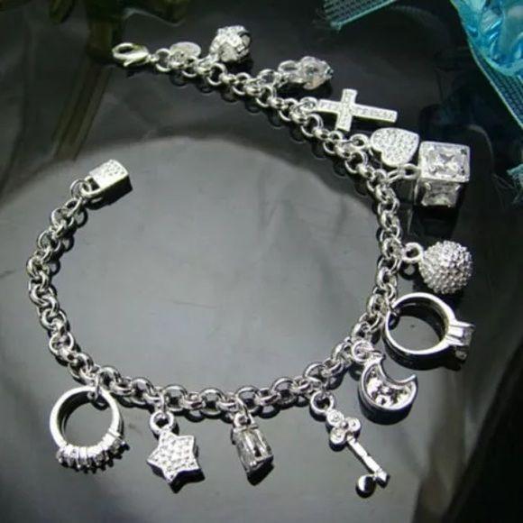 925 Sterling Silver Plated 13 Charm Bracelet Nice silver plated bracelet with 13 different charms. Really pretty fashion piece Jewelry Bracelets