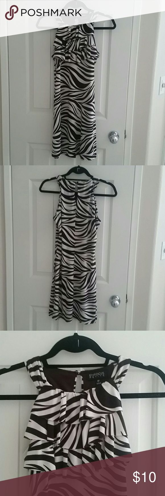 """Zebra print dress Cute every day dress Brown and white zebra print Chest features cascading layers Button closure at back neckline  No zipper, pull over Size 4 petite Flat Bust measurement 17"""" Enfocus Dresses Mini"""