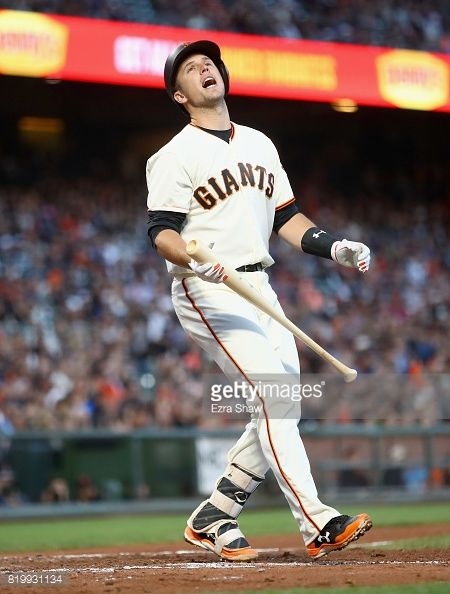 News Photo : Buster Posey of the San Francisco Giants reacts...