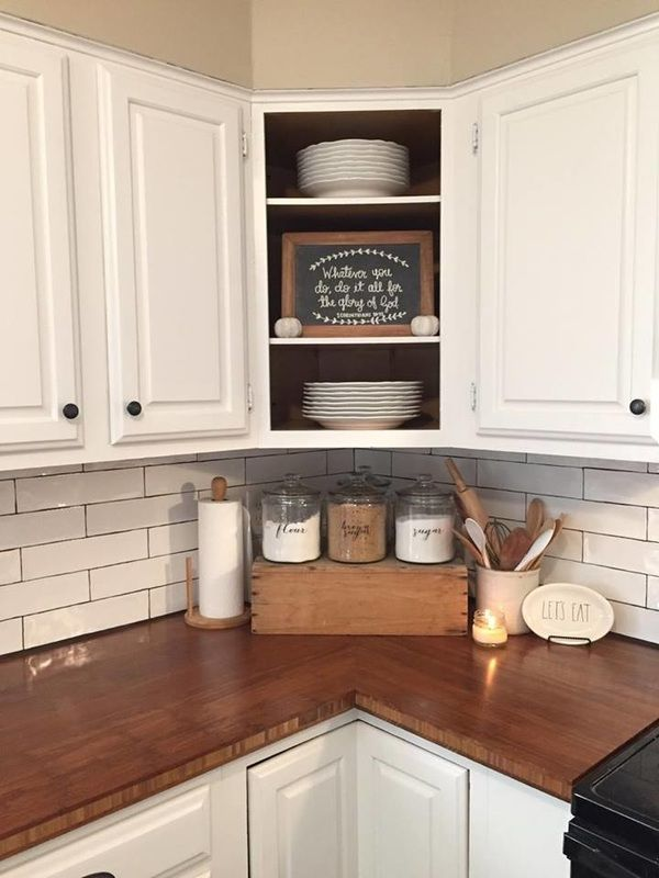 Farmhouse kitchen, butcher block, subway tile, open cabinets, kitchen counter decor, old crate, canisters, farmhouse decor.