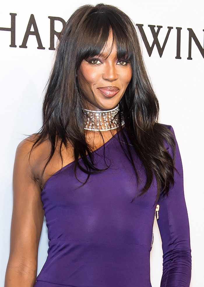 Naomi Campbell matches her violet eye shadow to her purple dress.