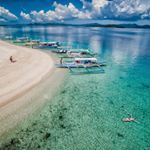 Enjoying a float in the crystal clear waters off Pass Island The next time we visit the Philippines we plan on camping on this island Would you camp on a remote islandPhoto Location Philippines