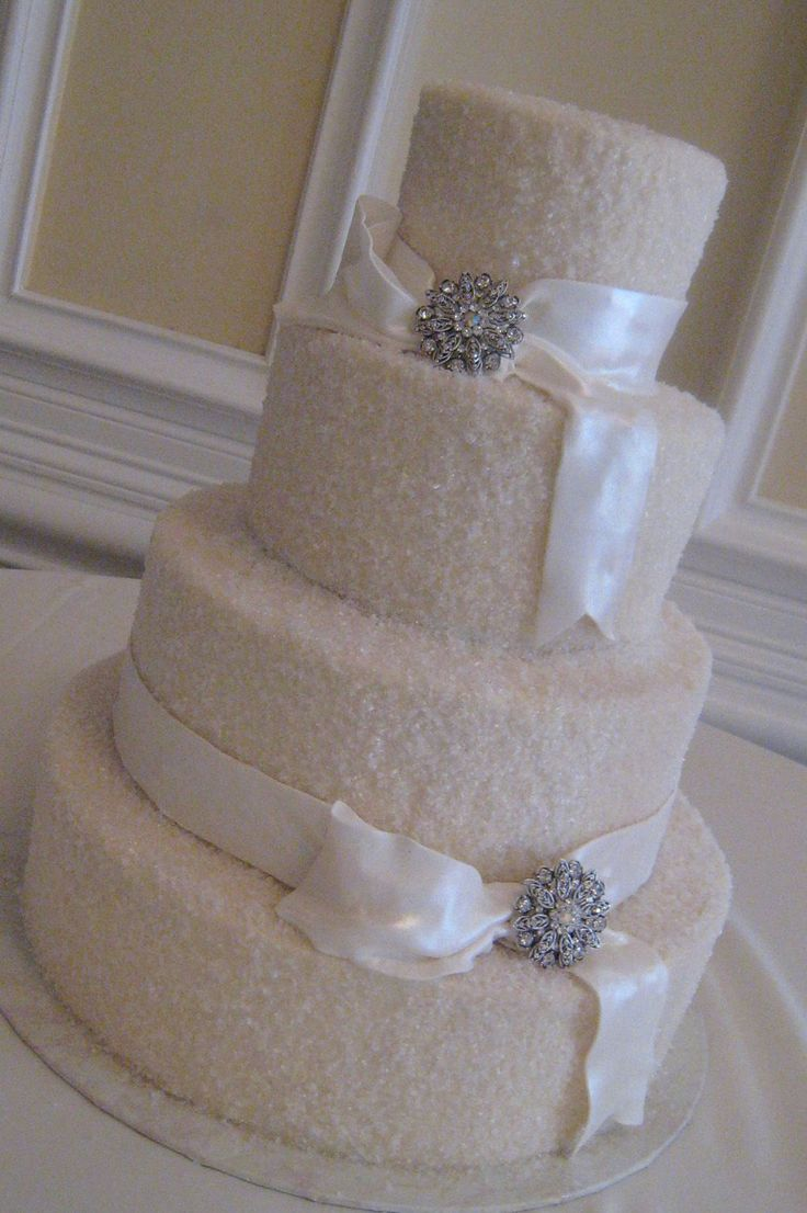 Sparkly wedding cake - Iced in buttercream & covered with sugar crystals, fondant ribbons and real brooch