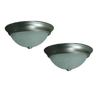The dreaded boob light fixtures. Most of us have them somewhere in our homes and most of us want to get rid of them....ASAP! They are cheap, unattractive, and look like giant breasts hanging from the ceiling, so what can be done?