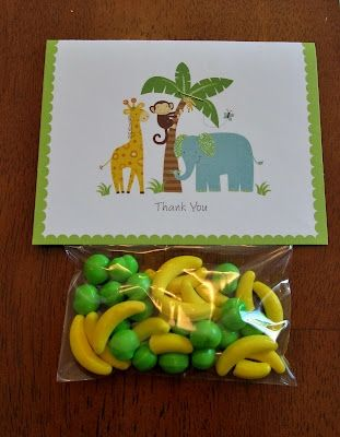 "Cute idea of a party favor. I love the use of the jungle-themed candy with the ""Thank-you"" note on top."