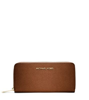 Michael Kors Jet Set Travel Zip-Around Saffiano Leather Continental Wallet; navy blue or black.