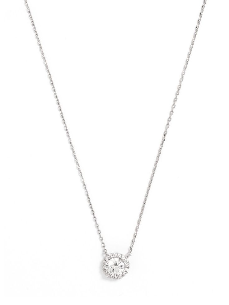 Neeeeeed this! A round gemstone surrounded by pavé crystals gives this necklace a worn-in, antique vibe, perfect for a whimsical or country wedding.