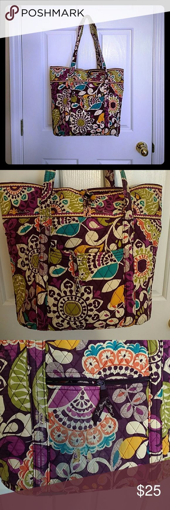 Vera Bradley Large Plum Crazy Tote FREE ID case! This is a Vera Bradley Large tote in the plum crazy retired pattern. Comes with free matching ID holder. These bags make perfect book bags and i absolutely adore them! I'm getting rid of some of my older patterns to make room for new ones. This bag has been professionally cleaned and I photoed the wear on the back side, straps and ID holder. The colors are still insanely vibrant which isn't common on used Veras. Comment with questions. I&#