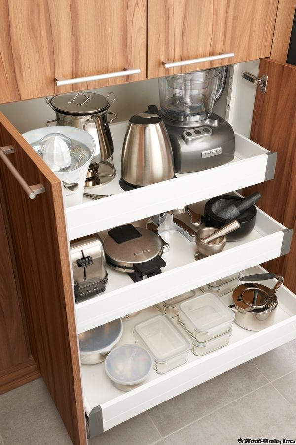 Pull-out drawers: small appliance storage area in kitchen.
