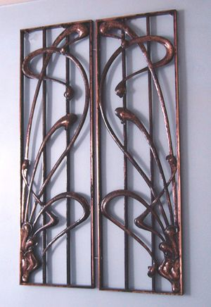 Two Art Nouveau security window grilles, mirror image of each other. Copperplated cast iron, from private home in Nancy, France. Very much the style of Hector Guimard of Paris Metro fame