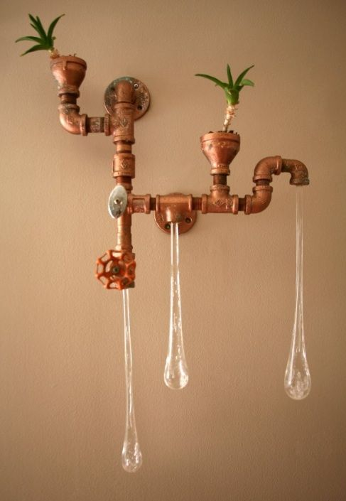 Light bulbs dripping from old pipes and faucets. Now should these go in the kitchen or bath?